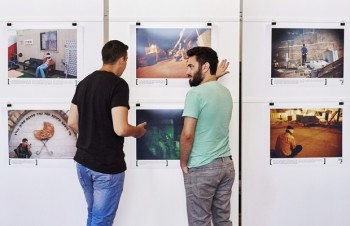 "Alon Sahar (L) and Shay Davidovich, both former Israeli army soldiers, discuss in front of photographs at an exhibition of the Israeli NGO ""Breaking the Silence"" at the Kulturhaus Helferei on June 3, 2015 in Zurich. Israel's Foreign Affairs strongly protested against the financial support provided by Switzerland to the exhibition organized by ""Breaking the Silence"", a very critical organization about its army.    AFP PHOTO / MICHAEL BUHOLZER -- RESTRICTED TO EDITORIAL USE, MANDATORY MENTION OF THE ARTIST UPON PUBLICATION, TO ILLUSTRATE THE EVENT AS SPECIFIED IN THE CAPTION -- / AFP / MICHAEL BUHOLZER"