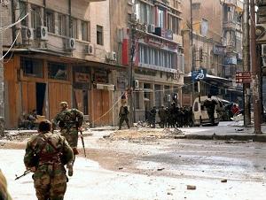 L'armée syrienne qui se déploie dans les vieux quarteirs d'Alep